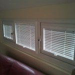 Perfect fit venetians down with louvres open.